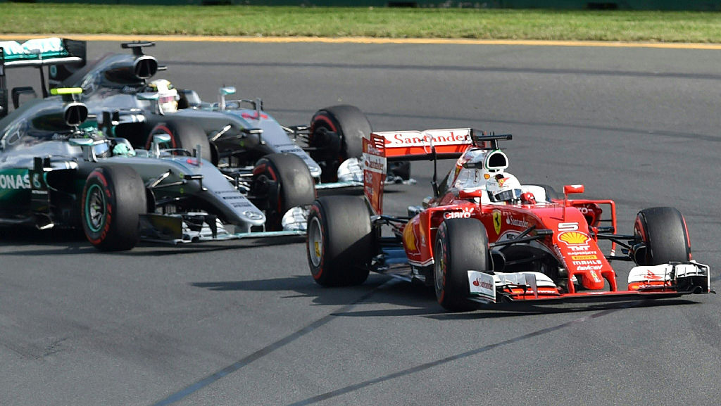 Ferrari's German driver Sebastian Vettel (R) drives during the start of the Formula One Australian Grand Prix in Melbourne on March 20, 2016.  / AFP / Peter PARKS / IMAGE STRICTLY RESTRICTED TO EDITORIAL USE  STRICTLY NO COMMERCIAL USE        (Photo credit should read PETER PARKS/AFP/Getty Images)