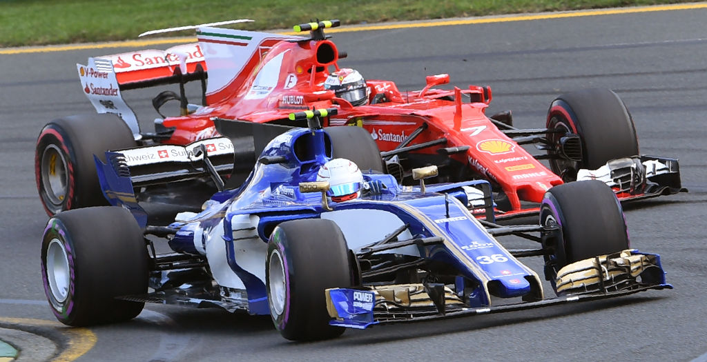 Sauber's Italian driver Antonio Giovinazzi (front) leads Ferrari's Finnish driver Kimi Raikkonen (rear) through a corner during the qualifying session for the Formula One Australian Grand Prix in Melbourne on March 25, 2017. / AFP PHOTO / WILLIAM WEST / -- IMAGE RESTRICTED TO EDITORIAL USE - STRICTLY NO COMMERCIAL USE --        (Photo credit should read WILLIAM WEST/AFP/Getty Images)