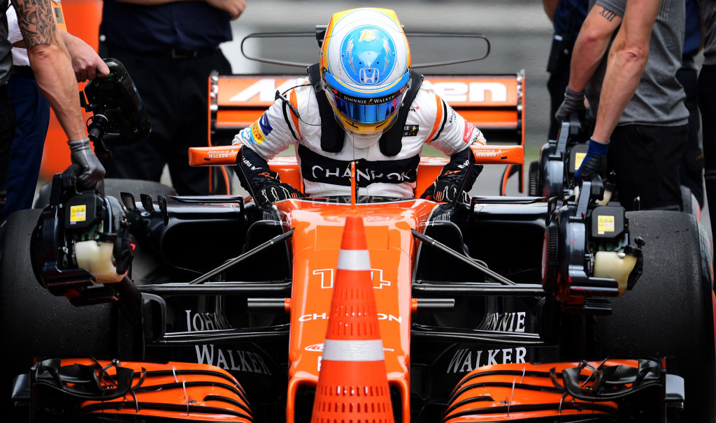 McLaren's Spanish driver Fernando Alonso steps out of his car after the third practice session for the Formula One Chinese Grand Prix in Shanghai on April 8, 2017. / AFP PHOTO / Johannes EISELE        (Photo credit should read JOHANNES EISELE/AFP/Getty Images)