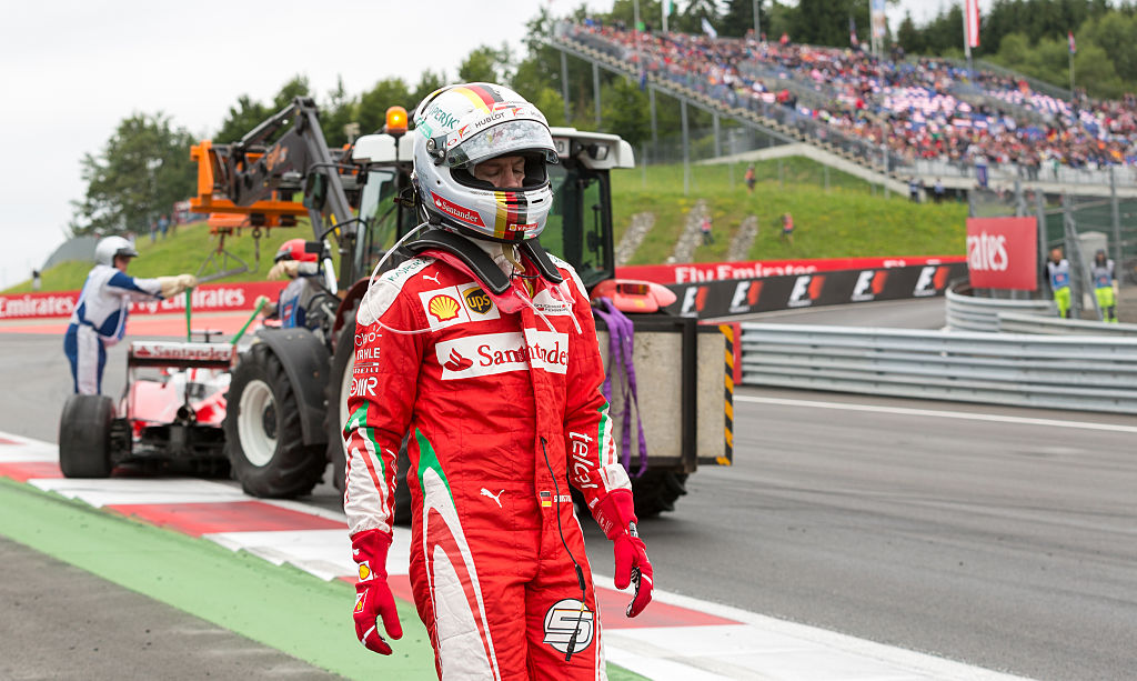 Ferrari's German driver Sebastian Vettel leaves the track after a crash during the Formula One Grand Prix of Austria at the Red Bull Ring in Spielberg, Austria on July 3, 2016.  / AFP / APA / EXPA/DOMINIK ANGERER / Austria OUT        (Photo credit should read EXPA/DOMINIK ANGERER/AFP/Getty Images)