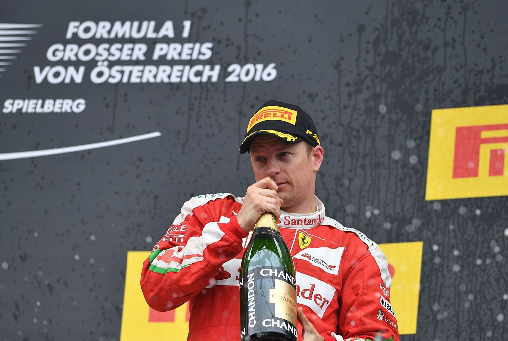 Ferrari's Finnish driver Kimi Raikkonen celebrates on the podium after the Formula One Grand Prix of Austria at the Red Bull Ring in Spielberg, Austria on July 3, 2016.   Mercedes AMG Petronas F1 Team's British driver Lewis Hamilton won the race ahead of Infiniti Red Bull racing's Belgian-Dutch driver Max Verstappen (2nd) and Ferrari's Finnish driver Kimi Raikkonen (3rd). / AFP / ANDREJ ISAKOVIC        (Photo credit should read ANDREJ ISAKOVIC/AFP/Getty Images)
