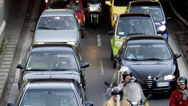 Rome residents queue with their cars and