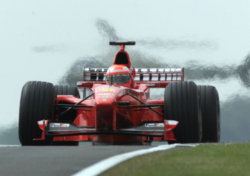 SILVERSTONE, UNITED KINGDOM:  Irish driver Eddie Irvine steers his Ferrari on the Silverstone racetrack, 10 July1999 during the third free practice session, one day before the 50th British Formula One Grand Prix. (ELECTRONIC IMAGE) (Photo credit should read PATRICK HERTZOG/AFP/Getty Images)