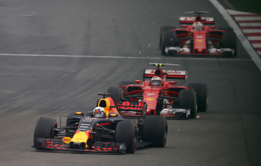 SHANGHAI, CHINA - APRIL 09: Daniel Ricciardo of Australia driving the (3) Red Bull Racing Red Bull-TAG Heuer RB13 TAG Heuer leads Kimi Raikkonen of Finland driving the (7) Scuderia Ferrari SF70H and Sebastian Vettel of Germany driving the (5) Scuderia Ferrari SF70H on track during the Formula One Grand Prix of China at Shanghai International Circuit on April 9, 2017 in Shanghai, China.  (Photo by Lars Baron/Getty Images)
