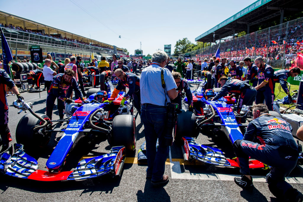 MONZA, ITALY - SEPTEMBER 03: Daniil Kvyat of Russia and Scuderia Toro Rosso and Carlos Sainz of Spain and Scuderia Toro Rosso on the grid before the Formula One Grand Prix of Italy at Autodromo di Monza on September 3, 2017 in Monza, Italy.  (Photo by Peter Fox/Getty Images)