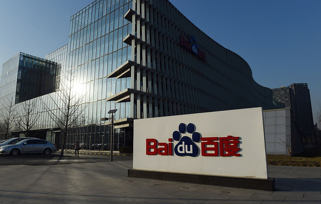 The Baidu logo is seen outside the Baidu headquarters in Beijing on December 17, 2014. Baidu, China's leading search engine, and ride sharing company Uber announced a strategic investment and cooperation agreement in Beijing on December 17. AFP PHOTO / Greg BAKER (Photo credit should read GREG BAKER/AFP/Getty Images)