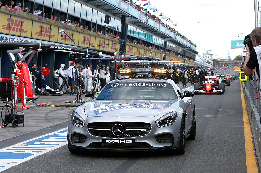 The safety car leads Formula One cars down the pit lane as a temporary suspension on the race was lifted following a crash between McLaren Honda's Spanish driver Fernando Alonso and Haas F1 Team's Brazilian driver Esteban Gutierrez during the Formula One Australian Grand Prix in Melbourne on March 20, 2016. / AFP / POOL / BRANDON MALONE / IMAGE STRICTLY RESTRICTED TO EDITORIAL USE  STRICTLY NO COMMERCIAL USE        (Photo credit should read BRANDON MALONE/AFP/Getty Images)