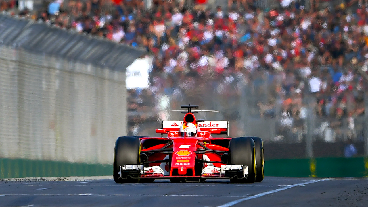 Ferrari's German driver Sebastian Vettel speeds down the main straight on the way to winning the Formula One Australian Grand Prix in Melbourne on March 26, 2017. / AFP PHOTO / WILLIAM WEST / --IMAGE RESTRICTED TO EDITORIAL USE - STRICTLY NO COMMERCIAL USE--        (Photo credit should read WILLIAM WEST/AFP/Getty Images)