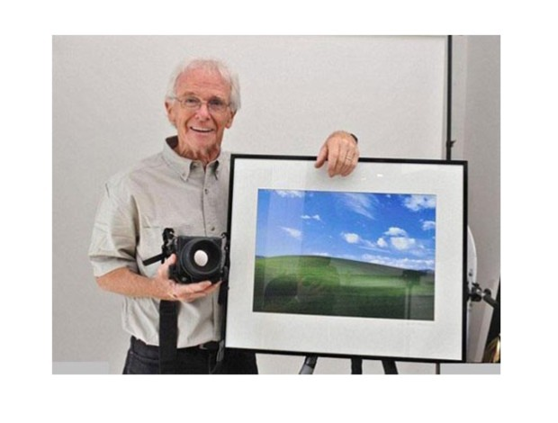 charles-orear-photographer-beside-framed-print-of-famous-windows-xp-photograph-bliss-desktop-wallpaper
