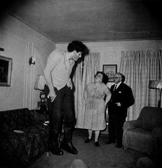 A Jewish giant at home with his parents in the Bronx, NY - 1970