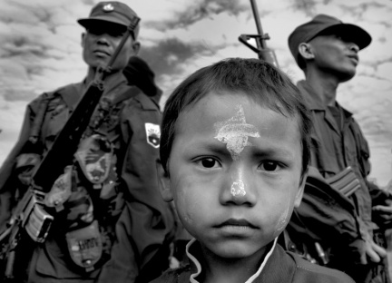 A boy participates in the 59th annual Revolution Day at Karen National Liberation Army headquarters in KNU (Karen National Unity)