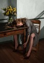 LOVE © YORAM ROTH, YELLOW PETALS RESTING ON THE TABLE