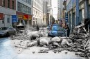 A women opens the door to her Mercedes on Sacramento Street while horses killed by falling rubble lie in the street. 2010 photo blend by Shawn Clover
