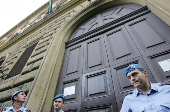 Italian penitentiary police stand in fro
