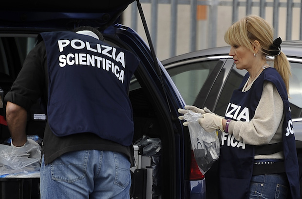 Italian scientific police  collect evide