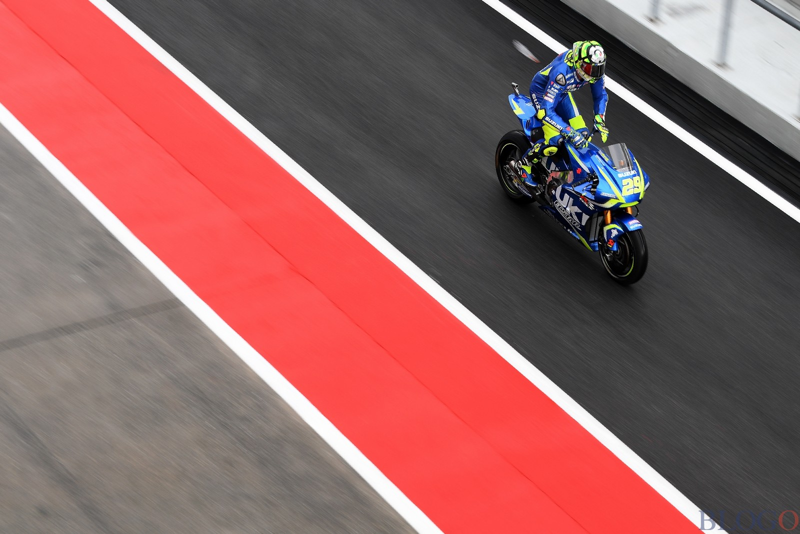 Suzuki Ecstar Italian rider Andrea Iannone rides out of the pit-lane during the second practice session of the Malaysia MotoGP at the Sepang International circuit on October 27, 2017. / AFP PHOTO / MANAN VATSYAYANA        (Photo credit should read MANAN VATSYAYANA/AFP/Getty Images)