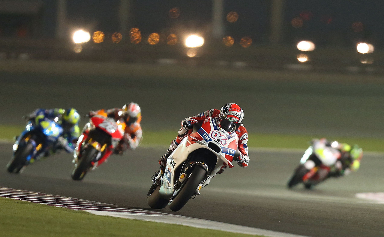 Italian rider Andrea Dovizioso (front) of Ducati Team steers his bike during the free practice session as part of the season-opening Qatar Grand Prix on March 19, 2016, at the Losail International Circuit in the capital Doha. / AFP / KARIM JAAFAR        (Photo credit should read KARIM JAAFAR/AFP/Getty Images)