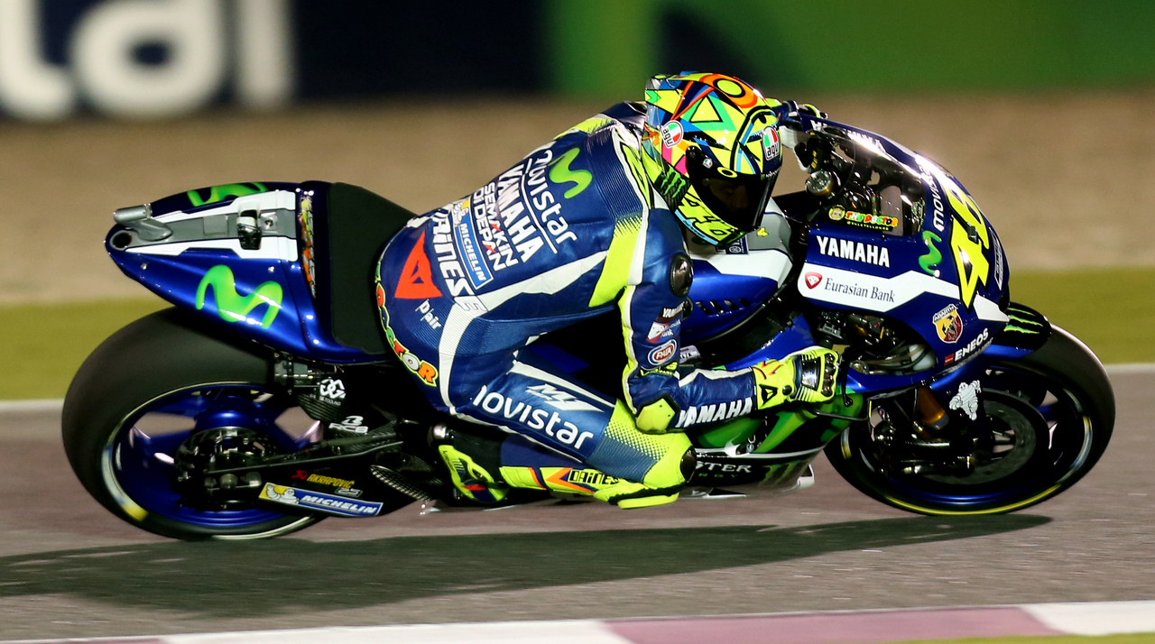 Italian rider Valentino Rossi of Movistar Yamaha MotoGP steers his bike during the free practice session as part of the season-opening Qatar Grand Prix on March 19, 2016, at the Losail International Circuit in the capital Doha. / AFP / KARIM JAAFAR        (Photo credit should read KARIM JAAFAR/AFP/Getty Images)