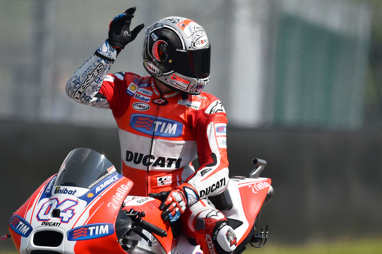 Italy's rider Andrea Dovizioso waves to fans on his Ducati during the third Free Practice session of the Italy's MotoGP Grand Prix on May 30, 2015 on the Mugello 's racetrack. AFP PHOTO / GABRIEL BOUYS        (Photo credit should read GABRIEL BOUYS/AFP/Getty Images)