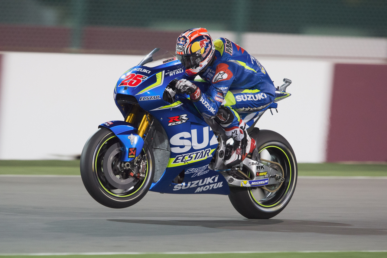 DOHA, QATAR - MARCH 18: Maverick Vinales of Spain and Team Suzuki ECSTAR lifts the front wheel during the MotoGp of Qatar - Free Practice at Losail Circuit on March 18, 2016 in Doha, Qatar.  (Photo by Mirco Lazzari gp/Getty Images)