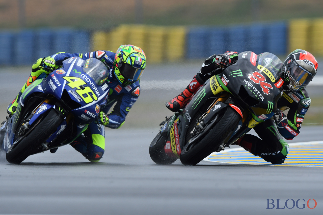 (From L) Italy's rider Valentino Rossi on his Movistar Yamaha MOTOGP N°46 competes next to Germany's rider Jonas Folger on his Monster Yamaha TECH 3 MOTOGP N°94 during a MotoGP free practice session ahead of the French Motorcycle Grand Prix, on May 19, 2017 in Le Mans, northwestern France. / AFP PHOTO / JEAN-FRANCOIS MONIER        (Photo credit should read JEAN-FRANCOIS MONIER/AFP/Getty Images)