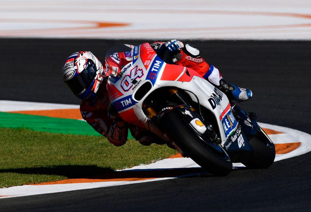 Ducati Team's Italian rider Andrea Dovizioso takes a curve during the first MotoGP free practice session of the Valencia Grand Prix at Ricardo Tormo racetrack in Cheste, near Valencia on November 10, 2017.  / AFP PHOTO / PIERRE-PHILIPPE MARCOU        (Photo credit should read PIERRE-PHILIPPE MARCOU/AFP/Getty Images)