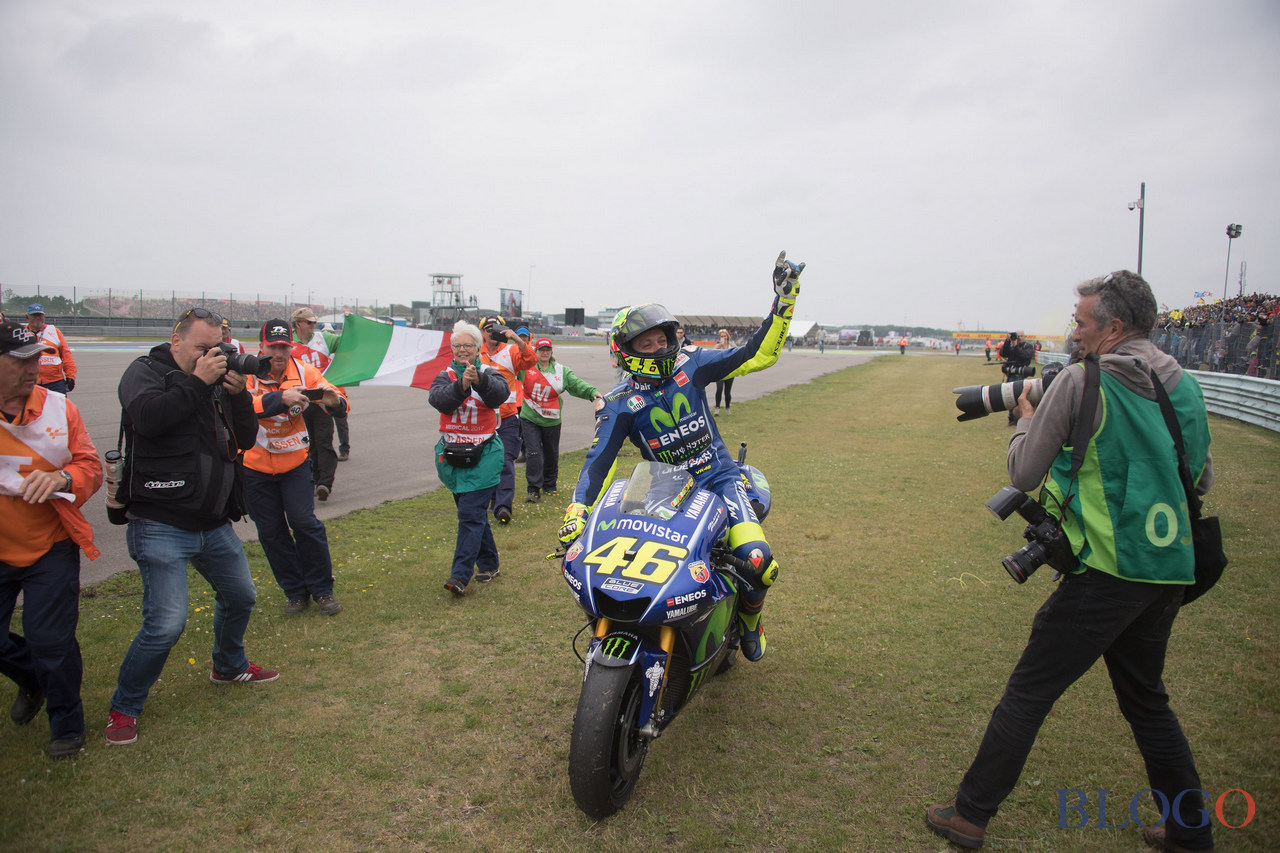 ASSEN, NETHERLANDS - JUNE 25:  Valentino Rossi of Italy and Movistar Yamaha MotoGP celebrates the victory with fans at the end of the MotoGP Race during the MotoGP Netherlands - RaceMotoGP Netherlands - Race on June 25, 2017 in Assen, Netherlands.  (Photo by Mirco Lazzari gp/Getty Images)