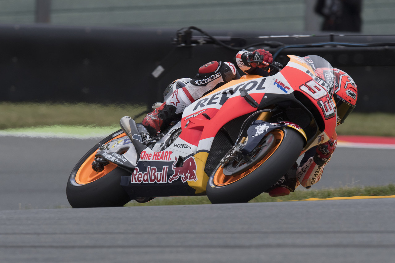 HOHENSTEIN-ERNSTTHAL, SAXONY - JULY 15:  Marc Marquez of Spain and Repsol Honda Team rounds the bend during the MotoGp of Germany - Free Practice at Sachsenring Circuit on July 15, 2016 in Hohenstein-Ernstthal, Germany.  (Photo by Mirco Lazzari gp/Getty Images)