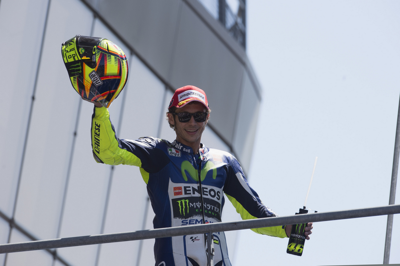 LE MANS, FRANCE - MAY 17:  Valentino Rossi of Italy and Movistar Yamaha MotoGP celebrates on the podium the second place at the end of the MotoGP race during the MotoGp of France - Race at  on May 17, 2015 in Le Mans, France.  (Photo by Mirco Lazzari gp/Getty Images)