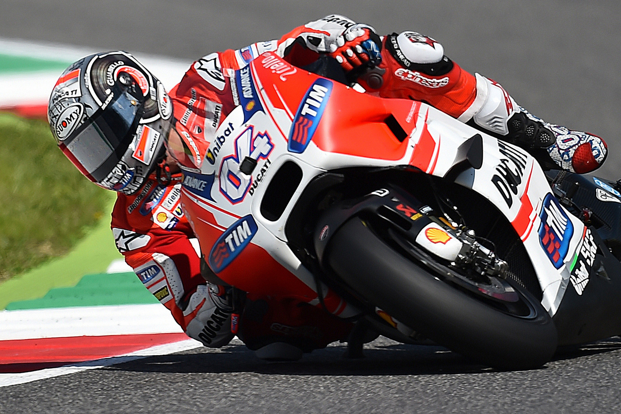 Italy's rider Andrea Dovizioso steers his Ducati during the third Free Practice session of the Italy's MotoGP Grand Prix on May 30, 2015 on the Mugello 's racetrack. AFP PHOTO / GABRIEL BOUYS        (Photo credit should read GABRIEL BOUYS/AFP/Getty Images)