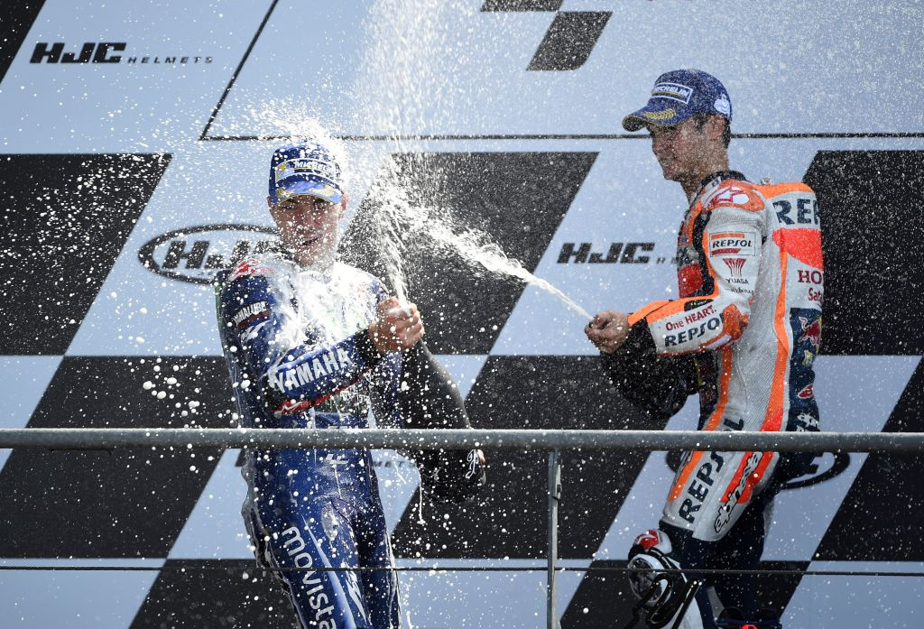 Winner Spain's rider Maverick Vinales (L) celebrates with second placed France's rider Johann Zarco on the podium after the MotoGP race of the French Motorcycle Grand Prix, on May 21, 2017 in Le Mans, northwestern France.  / AFP PHOTO / GUILLAUME SOUVANT        (Photo credit should read GUILLAUME SOUVANT/AFP/Getty Images)