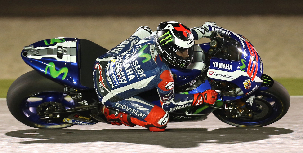 Spanish rider Jorge Lorenzo of Movistar Yamaha MotoGP steers his bike during the free practice session as part of the season-opening Qatar Grand Prix on March 19, 2016, at the Losail International Circuit in the capital Doha. / AFP / KARIM JAAFAR        (Photo credit should read KARIM JAAFAR/AFP/Getty Images)