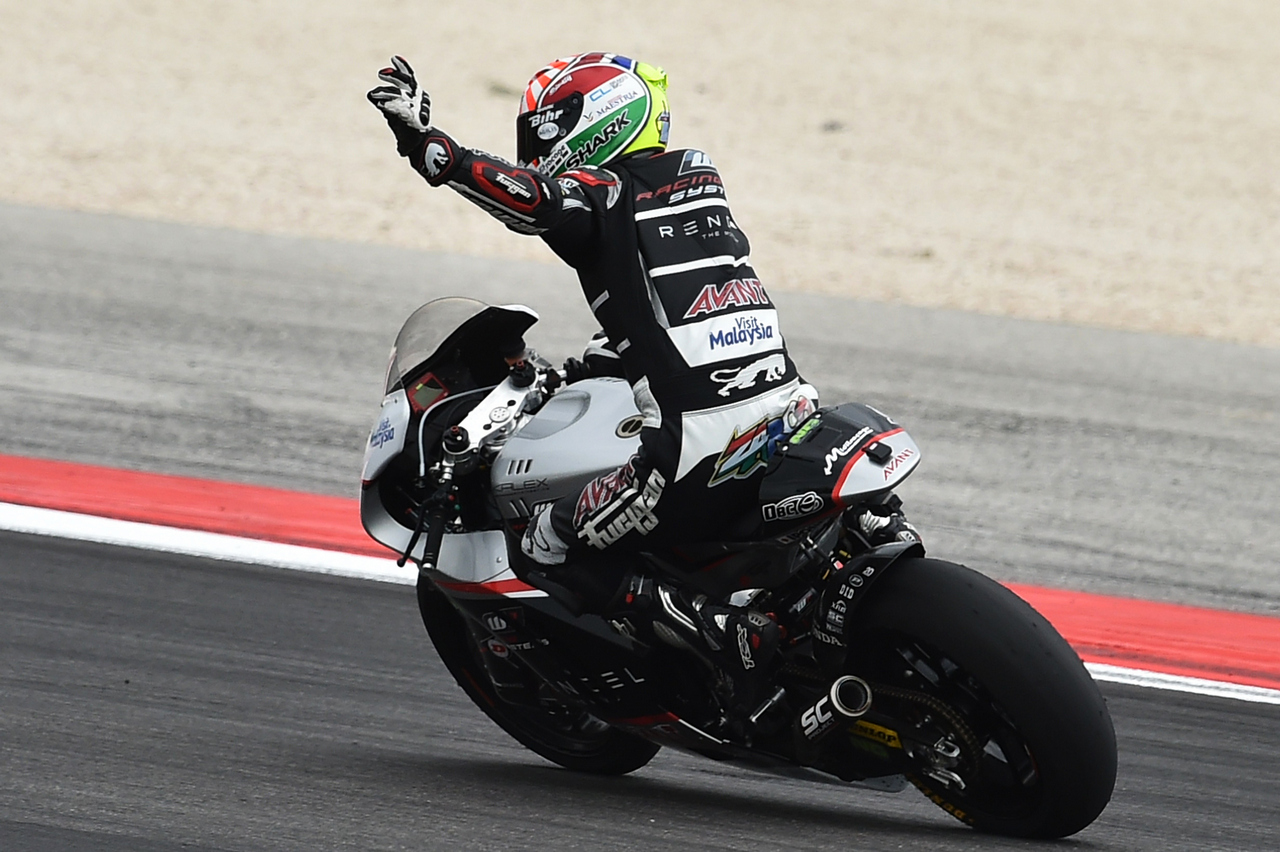 Ajo Motorsport's French rider Johann Zarco celebrates after winning the Moto 2 race of the San Marino MotoGP, in Misano Adriatico on September 13, 2015  AFP PHOTO / ALBERTO PIZZOLI        (Photo credit should read ALBERTO PIZZOLI/AFP/Getty Images)