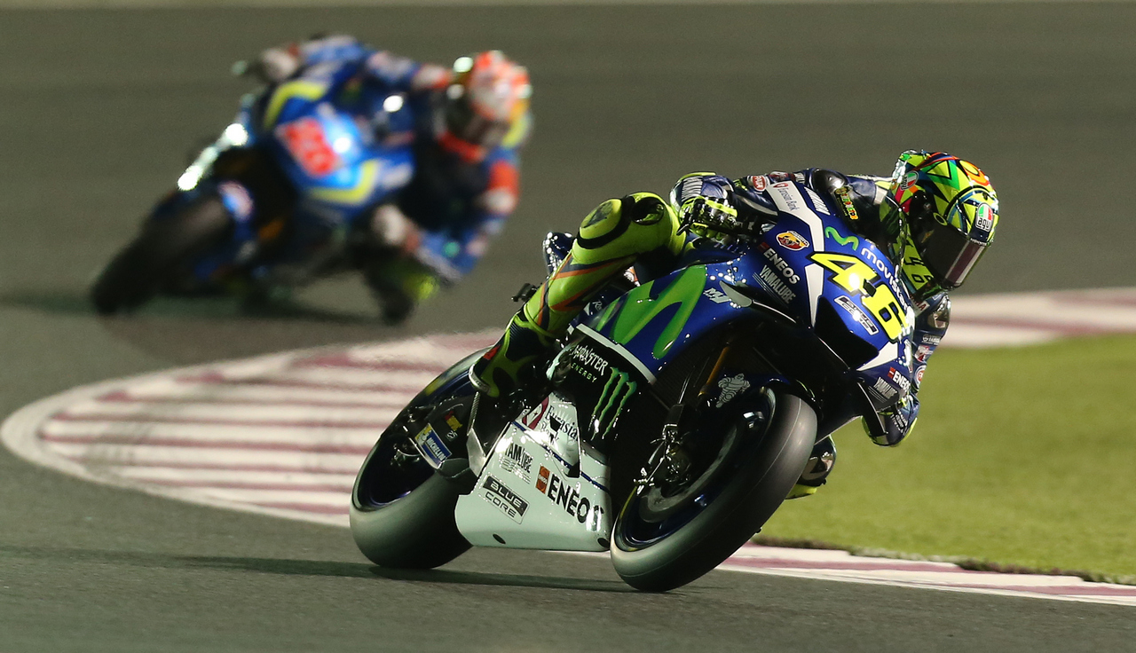 Italian rider Valentino Rossi of Movistar Yamaha MotoGP team steers his bike during the free practice session as part of the season-opening Qatar Grand Prix on March 19, 2016, at the Losail International Circuit in the capital Doha. / AFP / KARIM JAAFAR        (Photo credit should read KARIM JAAFAR/AFP/Getty Images)