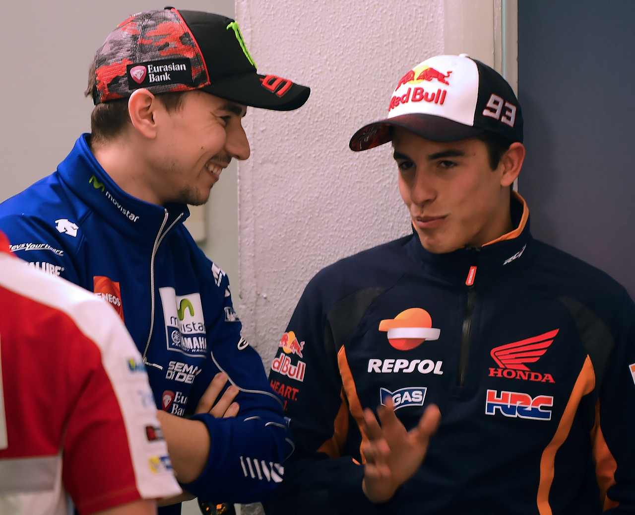 Repsol Honda Team's Spanish rider Marc Marquez (R) speaks with Movistar Yamaha MotoGP's Spanish rider Jorge Lorenzo (L) before a press conference during the Spanish Grand Prix at the Jerez racetrack in Jerez de la Frontera on April 21, 2016. / AFP / Cristina Quicler        (Photo credit should read CRISTINA QUICLER/AFP/Getty Images)